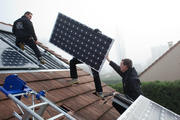 Solar panels being installed on a rooftop