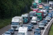 Lorries, commercial vehicles and cars driving on a motorway