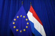 The national flag of Luxembourg next to the European flag