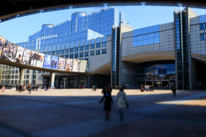 European Parliament headquarters in Brussels - Spring season. ' Inside-out ' Photo exhibition on passerelle Adenauer